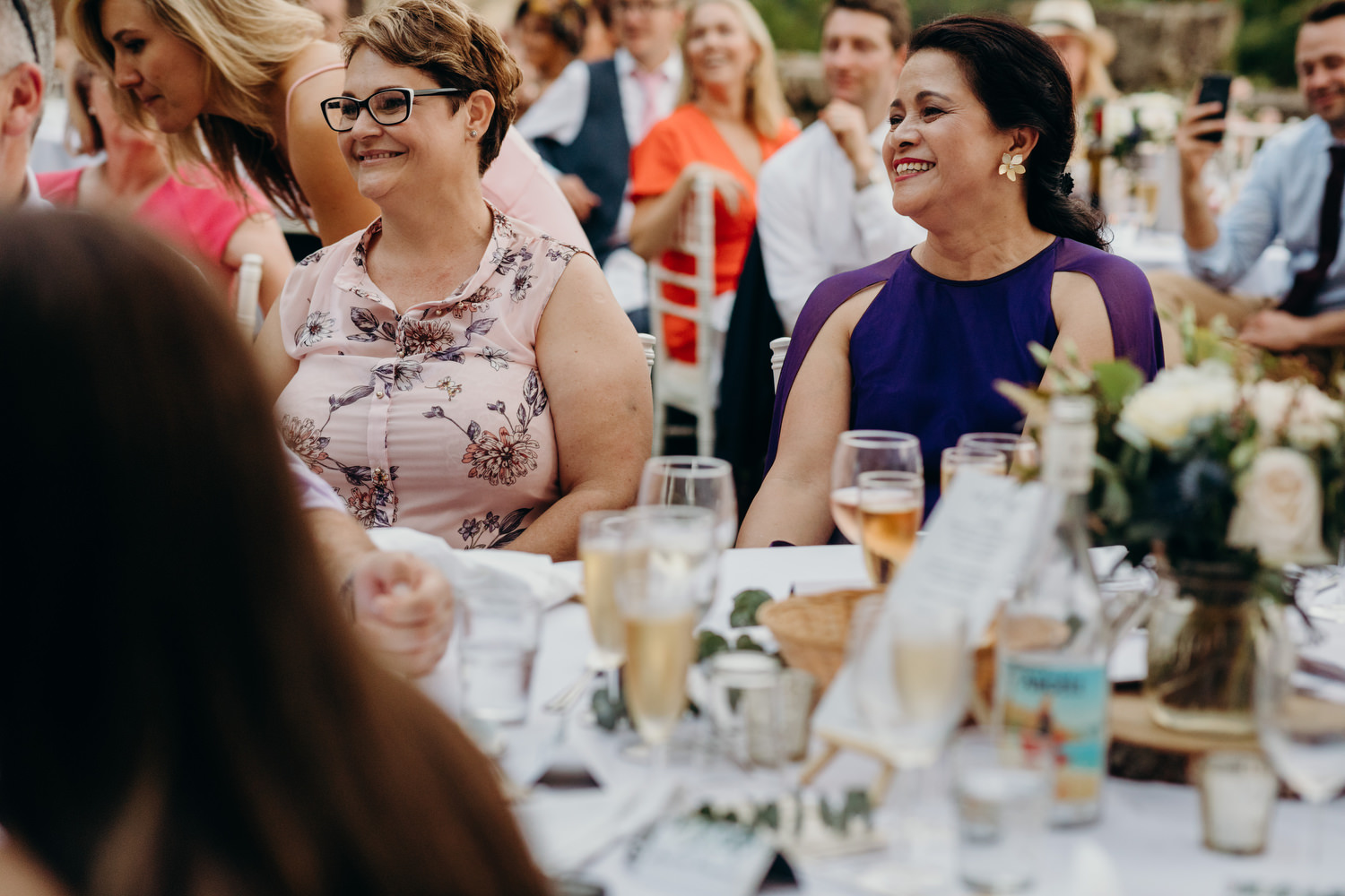 guests smiling during wedding reception