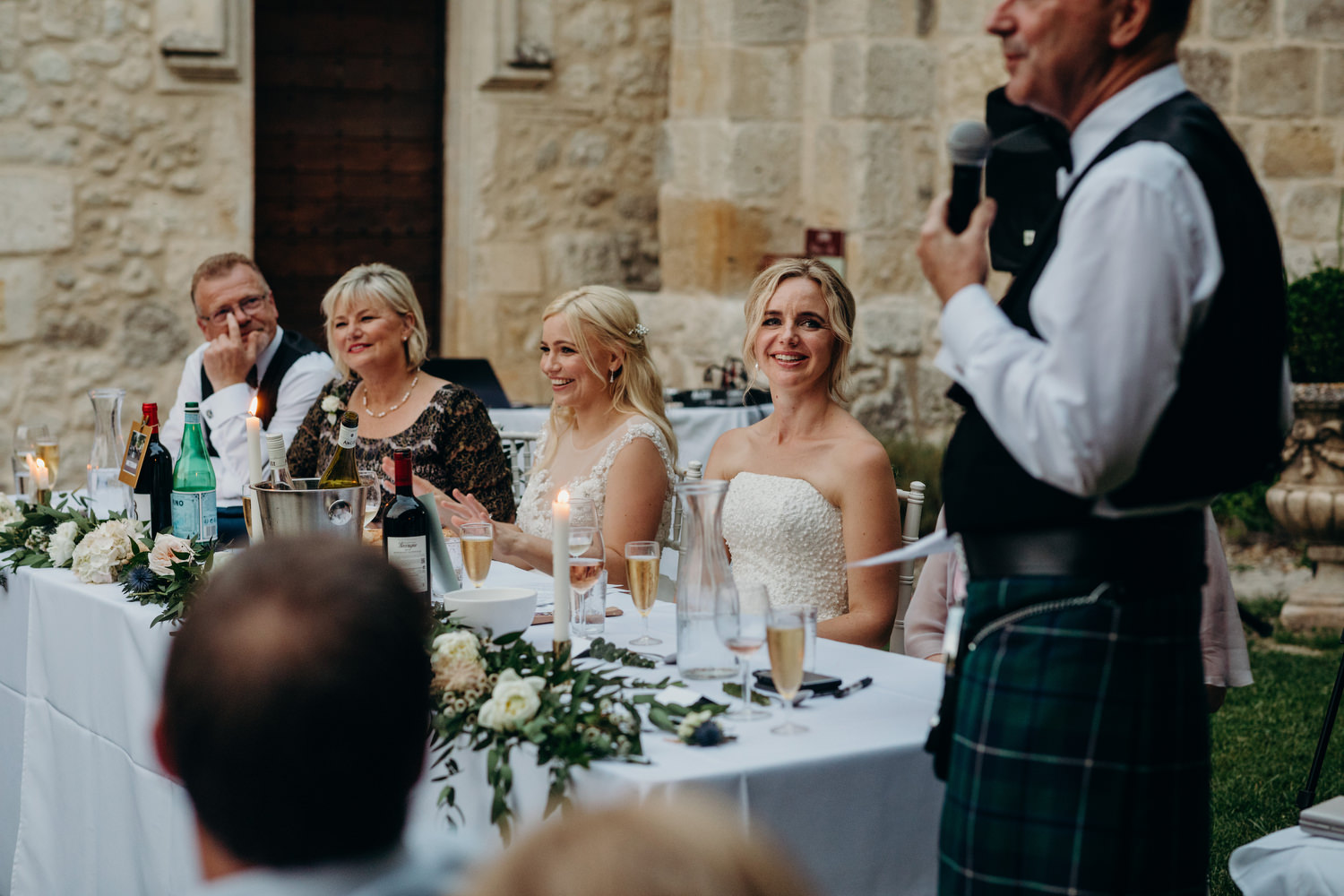 Bride looks at father during speech