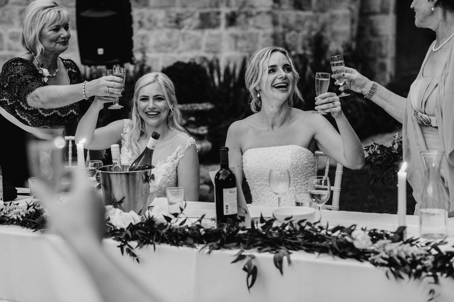 brides cheering champagne