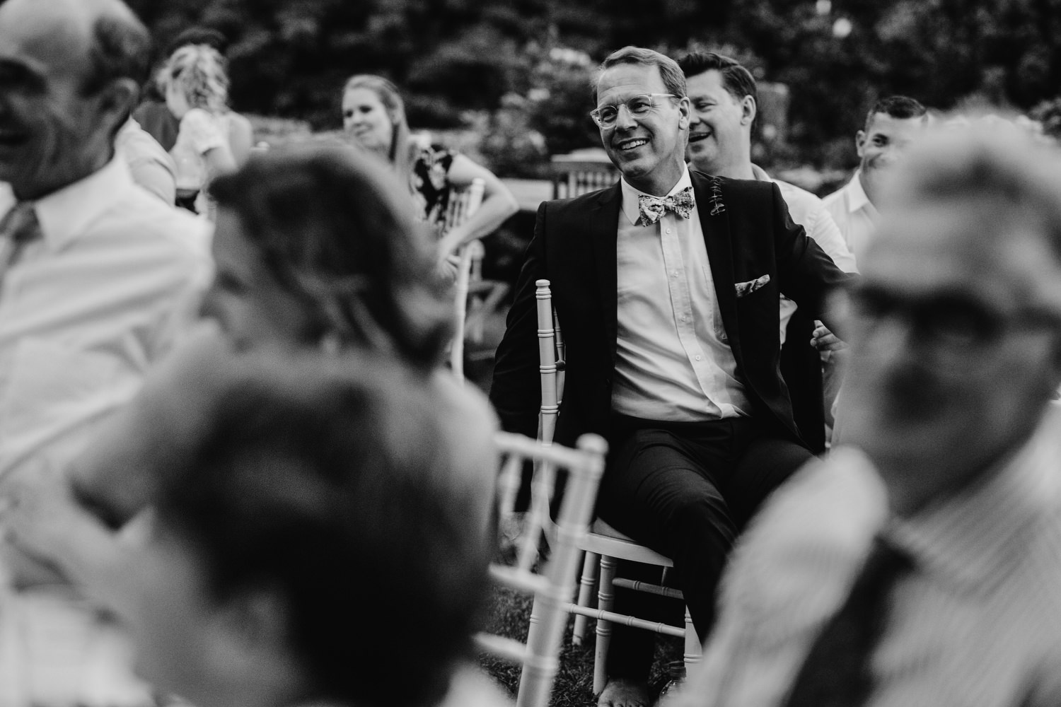 Black and white photograph of wedding guest