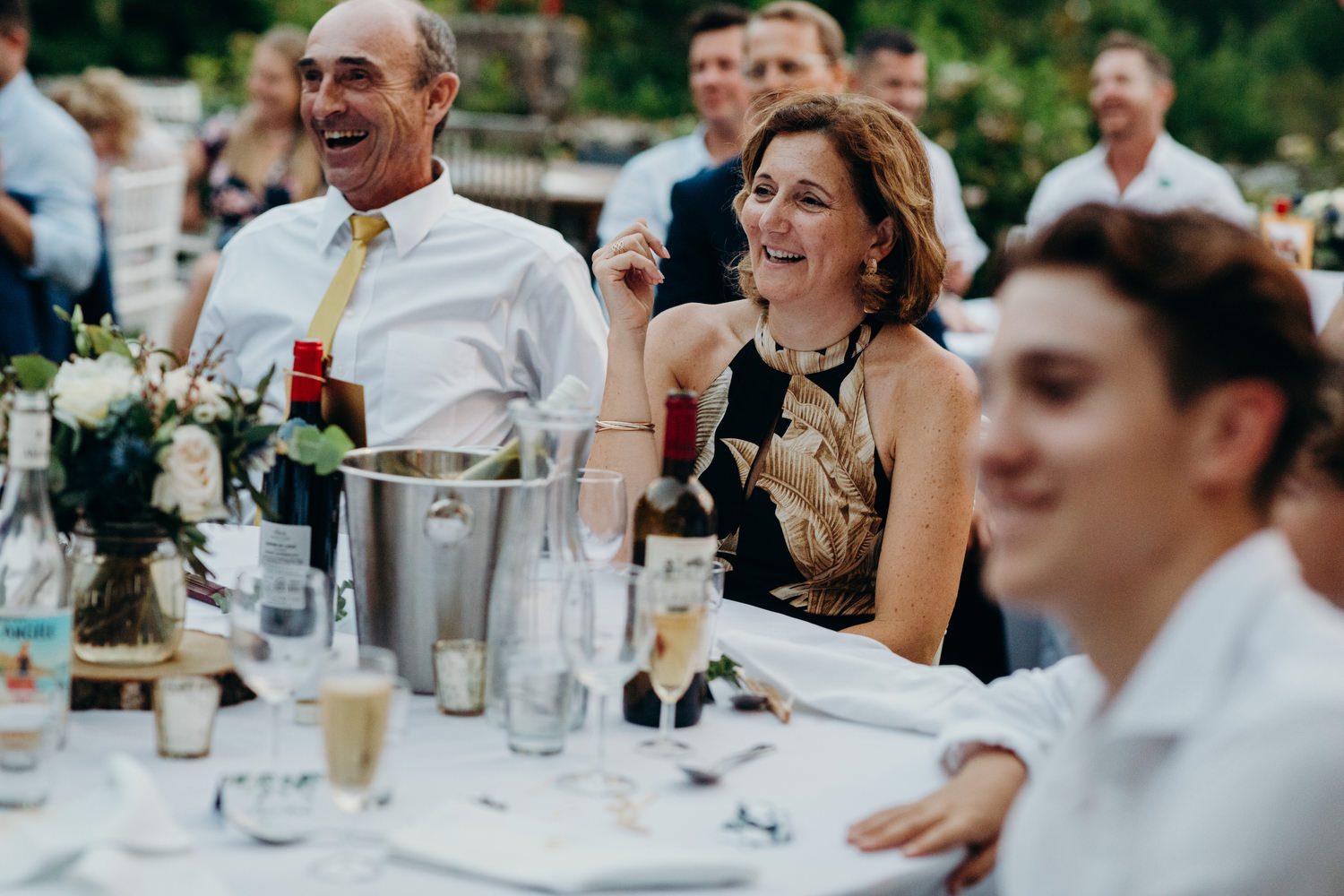 woman and man laughing at wedding speech