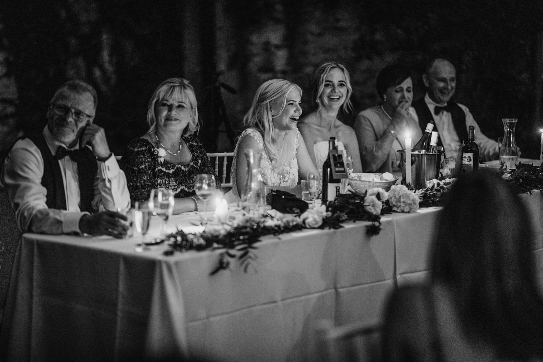 main table laughing at wedding
