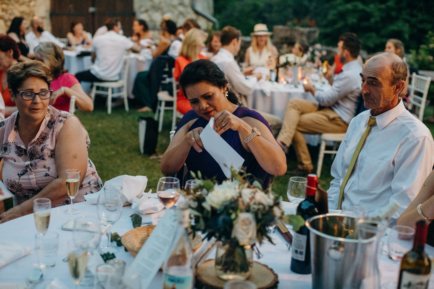guests opening table games at wedding