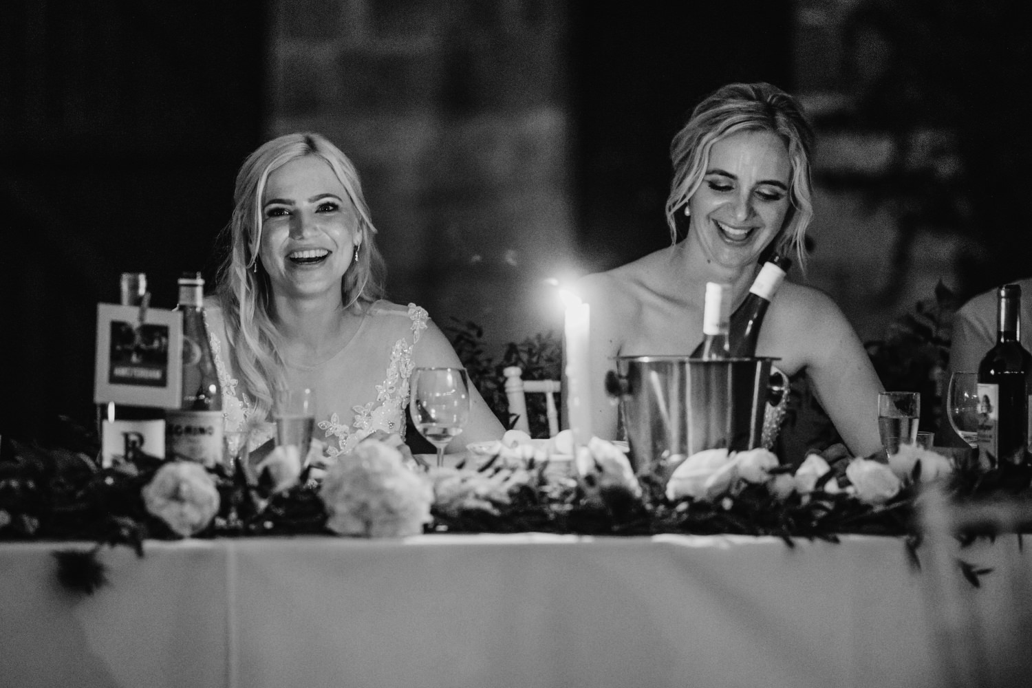 brides laugh during friends speech