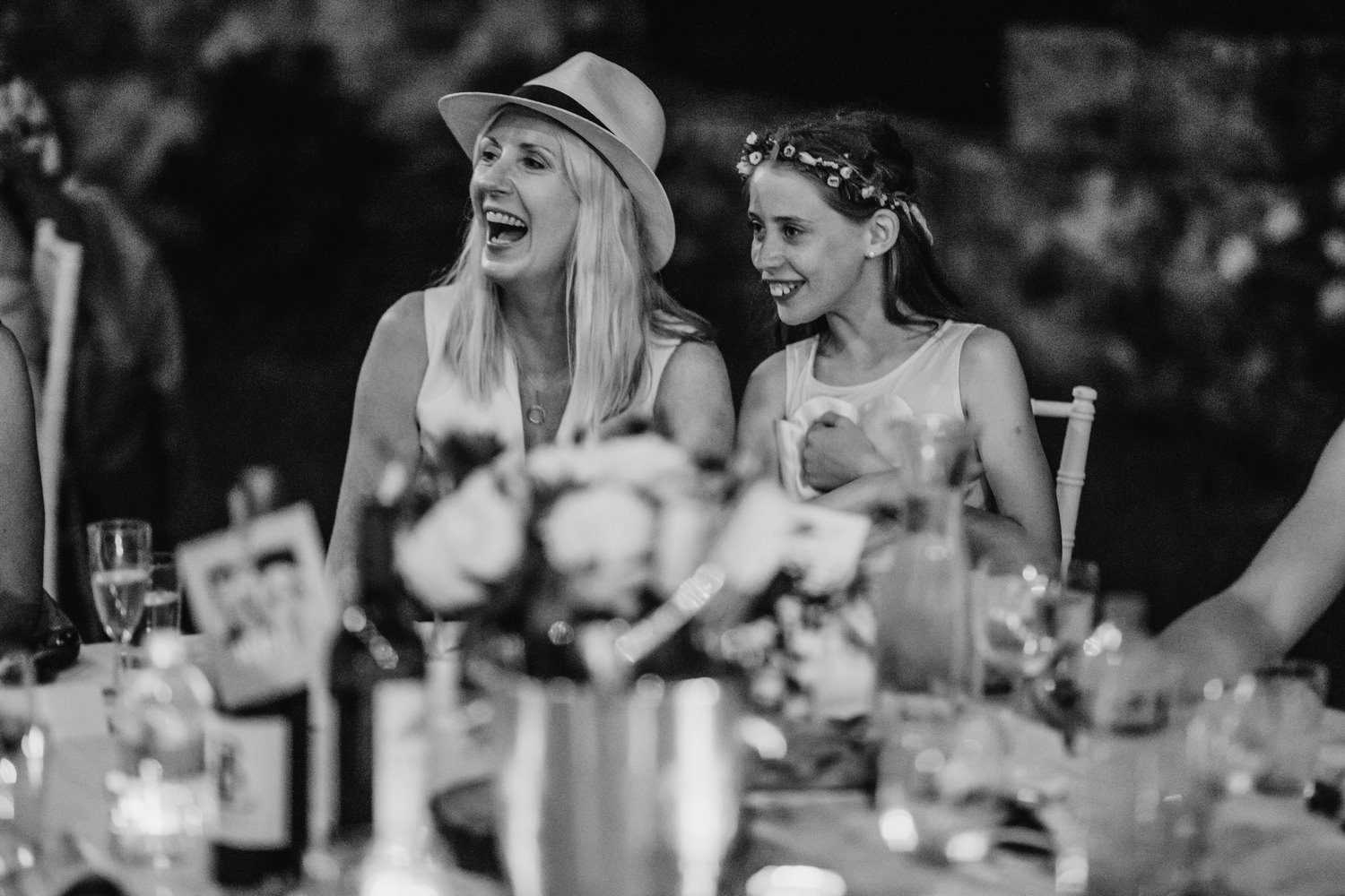 Mother and daughter laugh during speeches