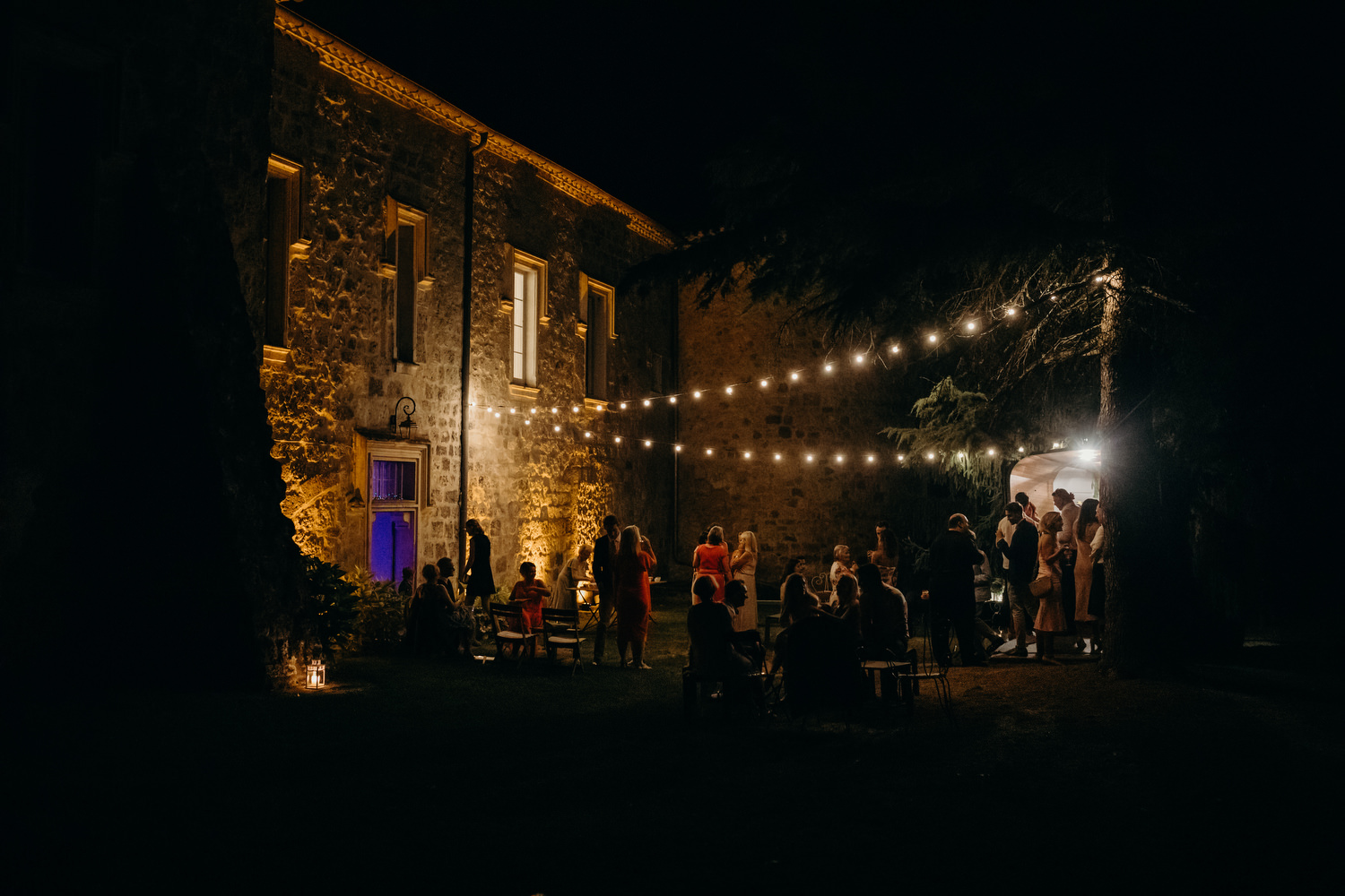 chateau terrace lit up with fairy lights