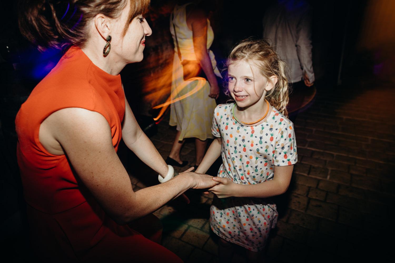 kid dances at a wedding