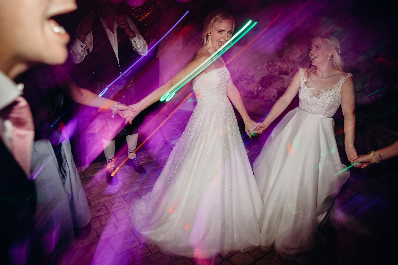 brides enjoy dancing at wedding