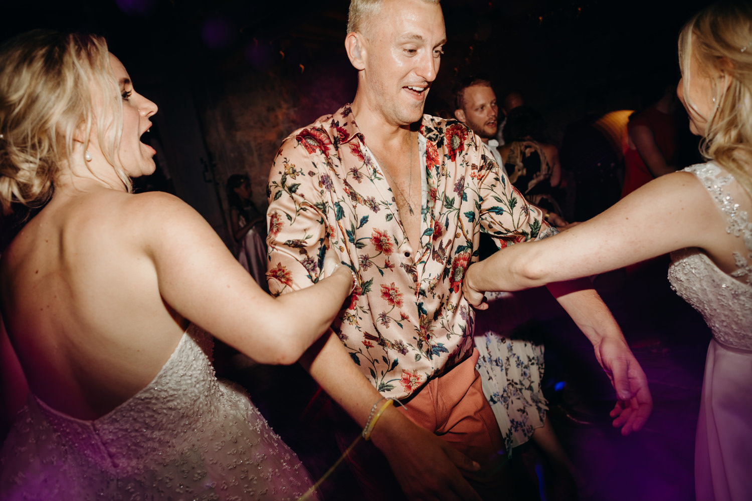 guests enjoy Ceilidh dance at french wedding
