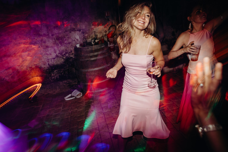 Smiling woman dances at wedding