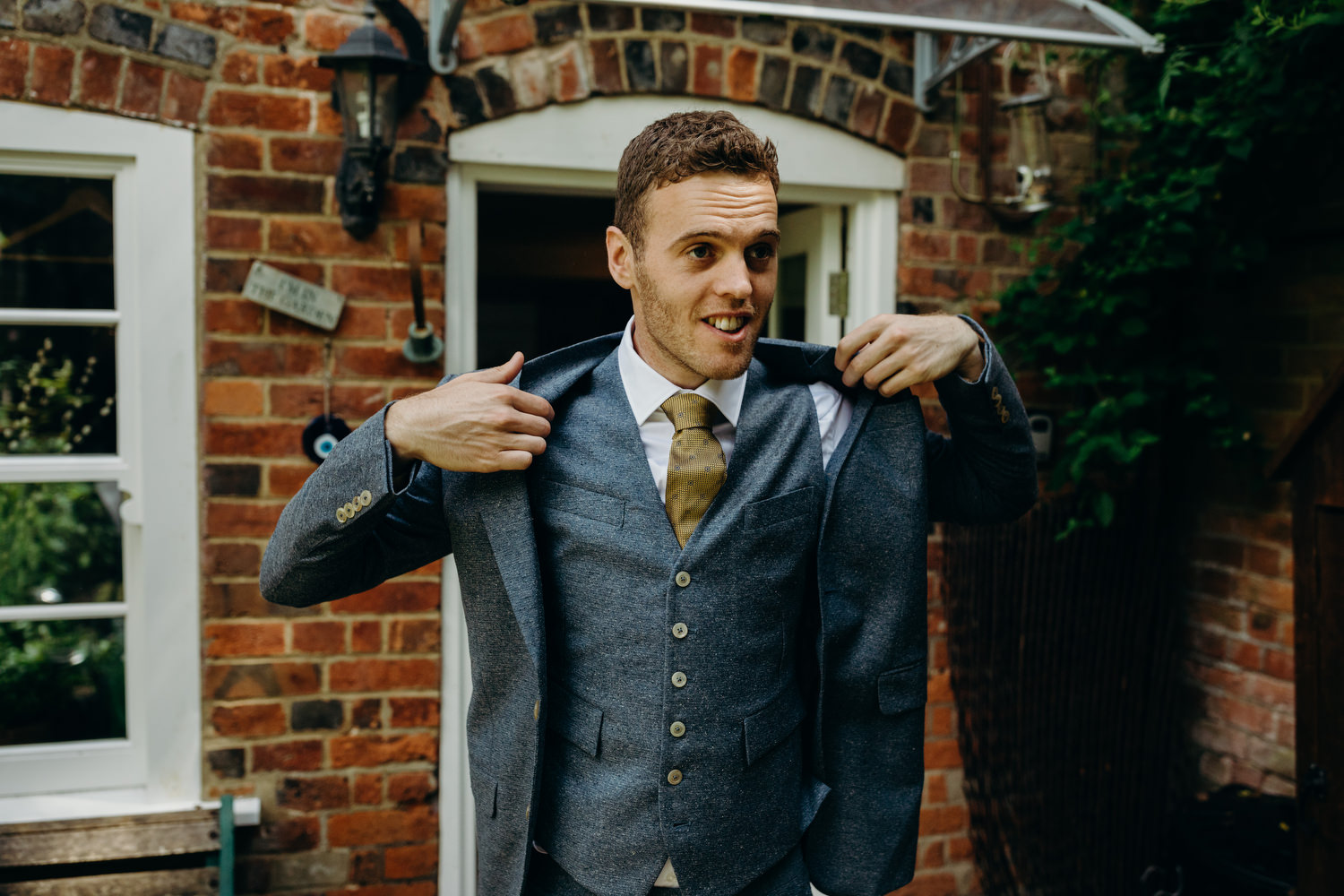 groom gets ready in garden