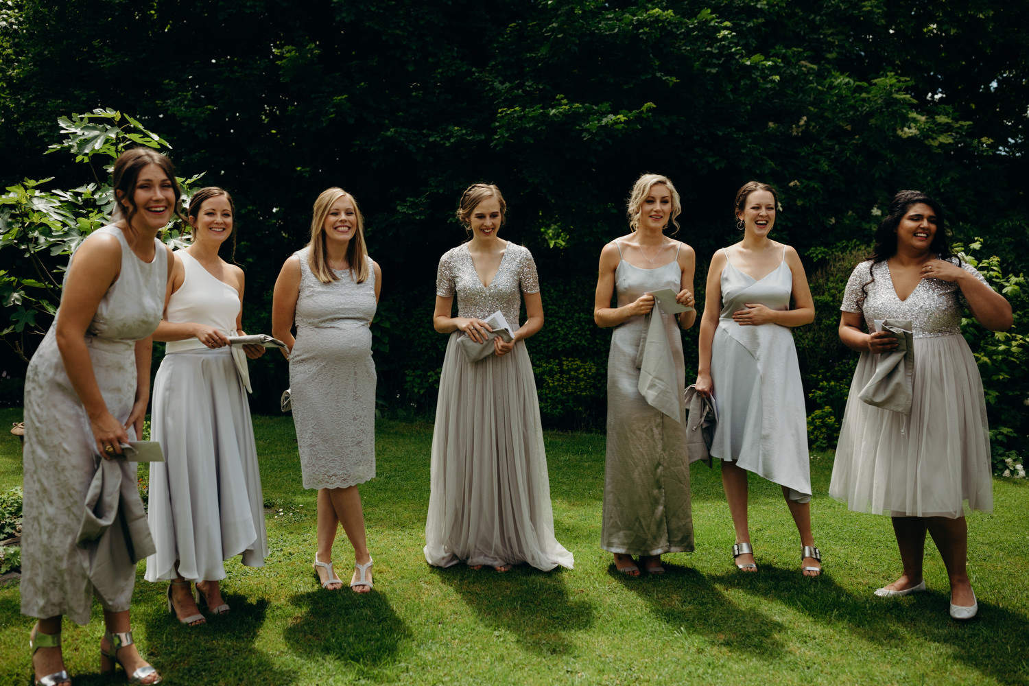 bridesmaids wearing silver dresses