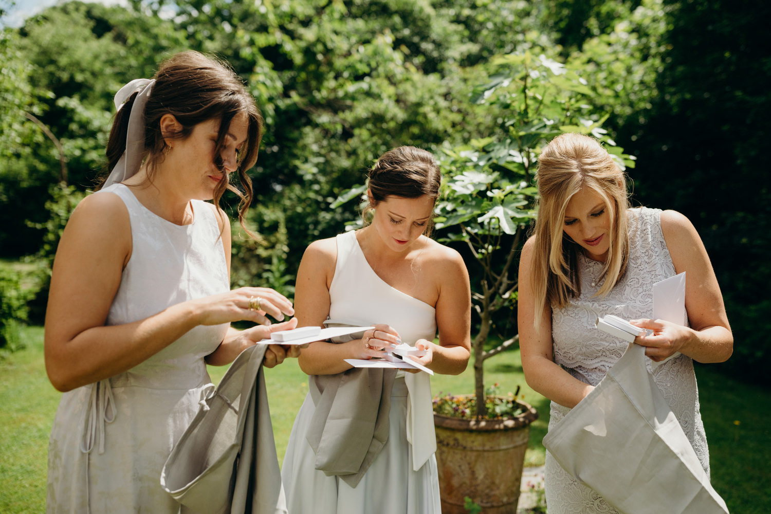 bridesmaids opening wedding gifts