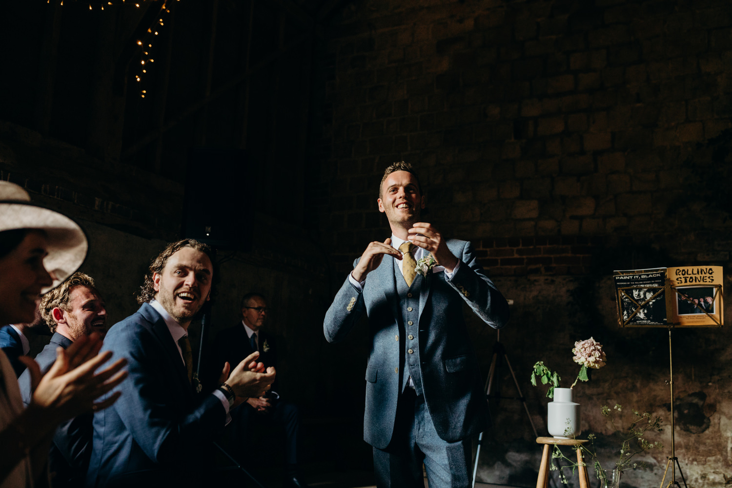 groom claps before wedding