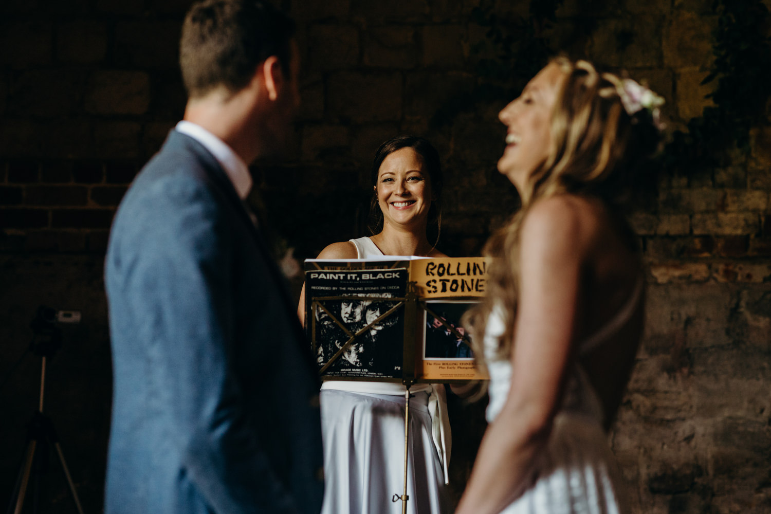 wedding guest reads during ceremony