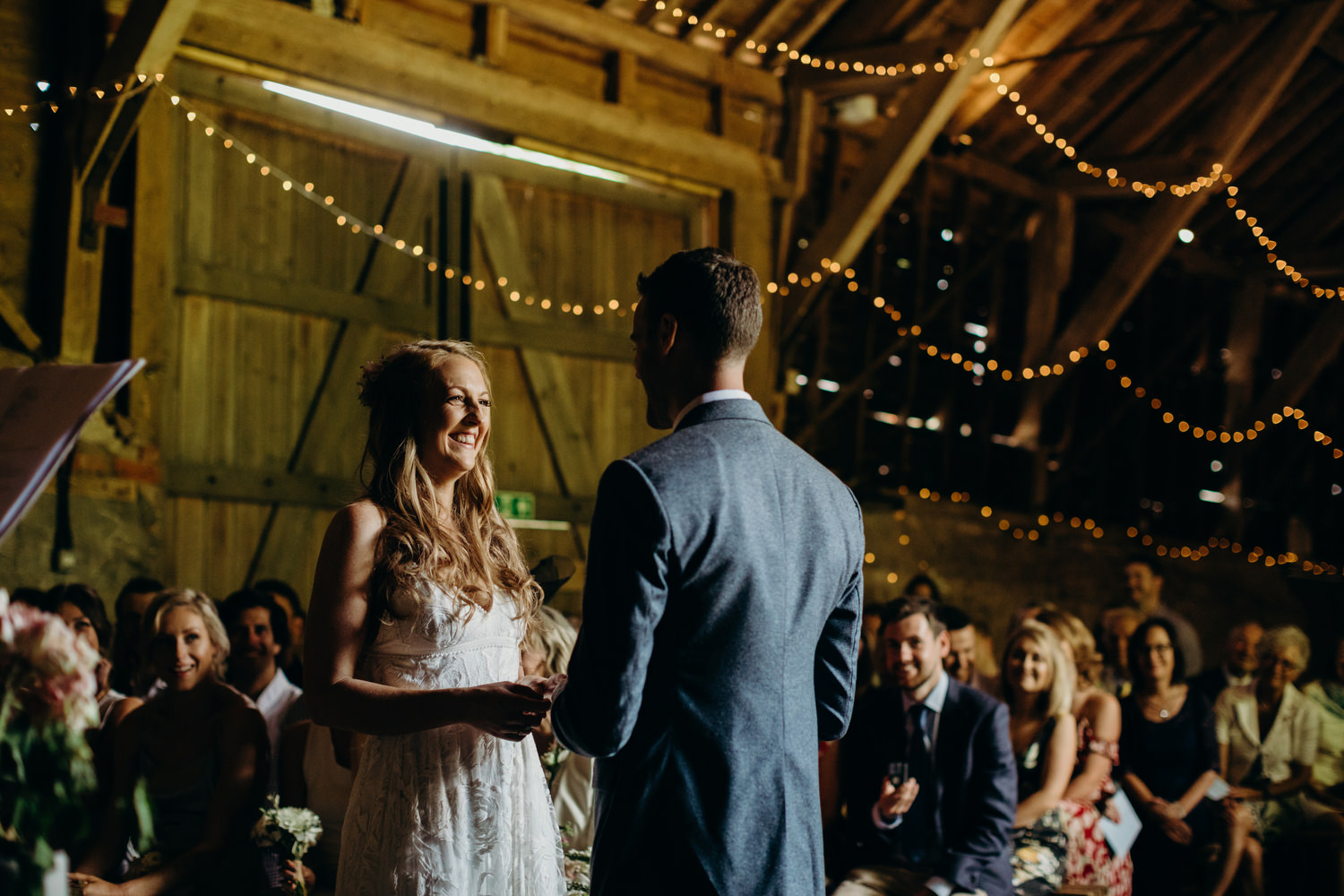 bride laughing during barn wedding