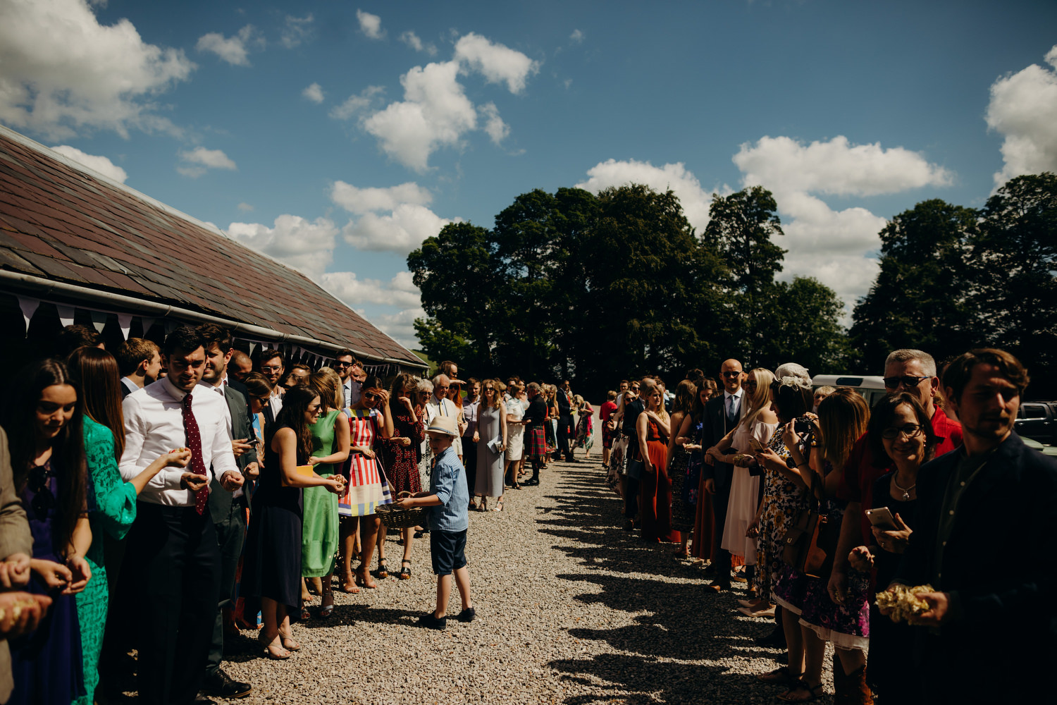 wedding guests line up for confetti