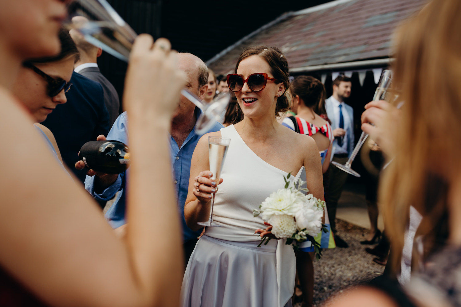 Bridesmaid with shades smiles