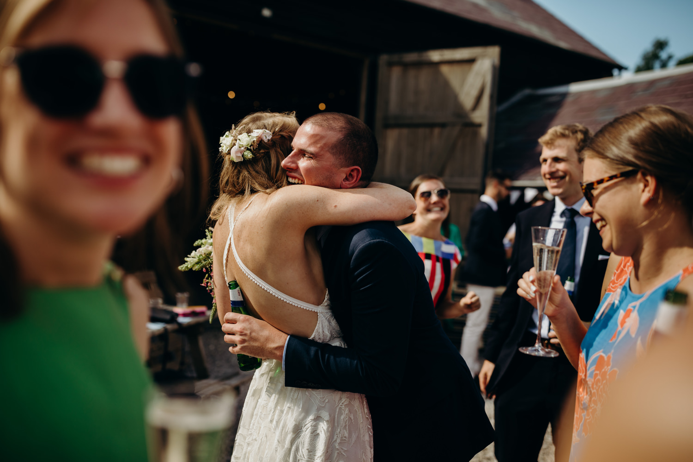 guests hugging bride