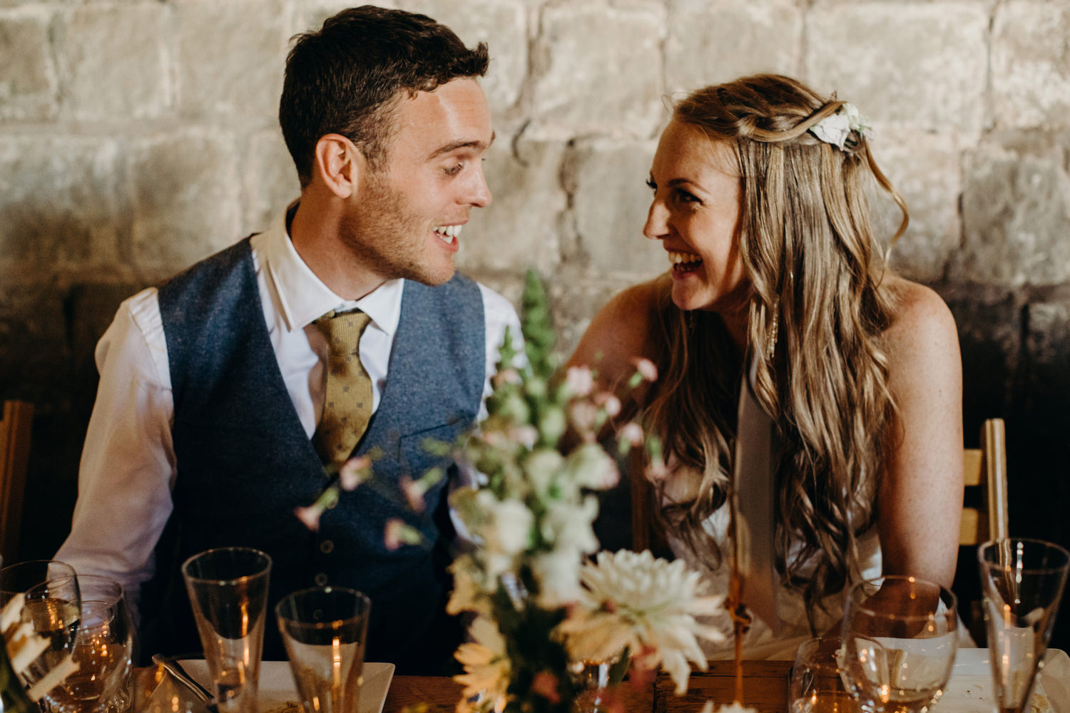 newly weds laugh at wedding breakfast