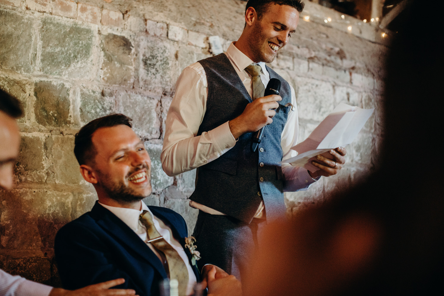 Groom smiles while doing speech