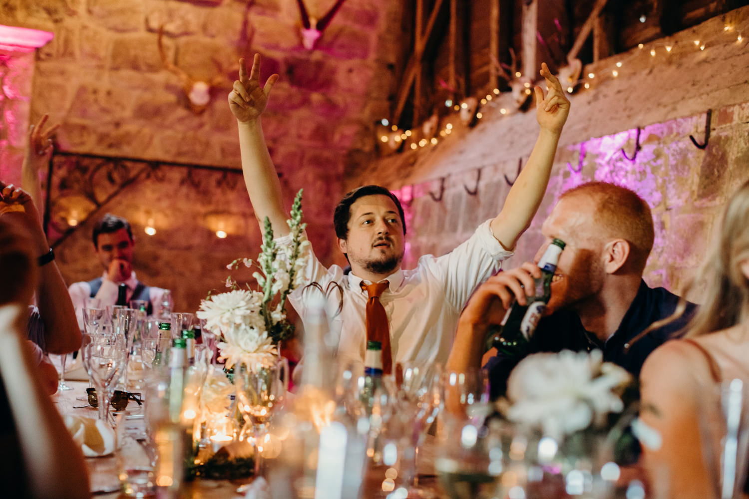 Man puts hands up at wedding