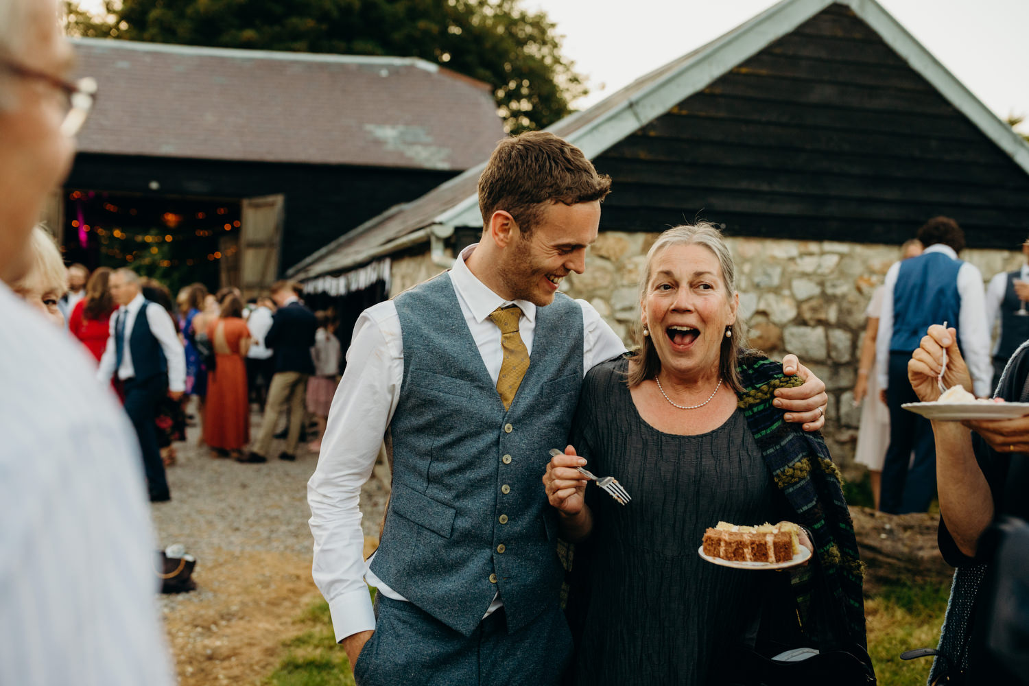 guest eating cake at wiltshire wedding