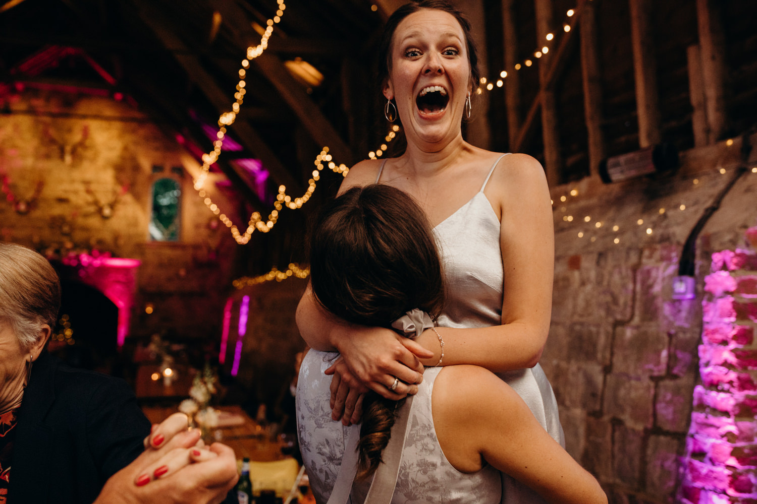 bridesmaid having fun at wedding