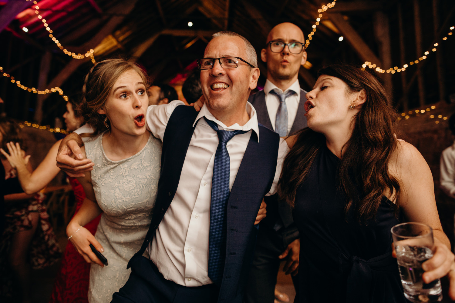 guests sing at wedding
