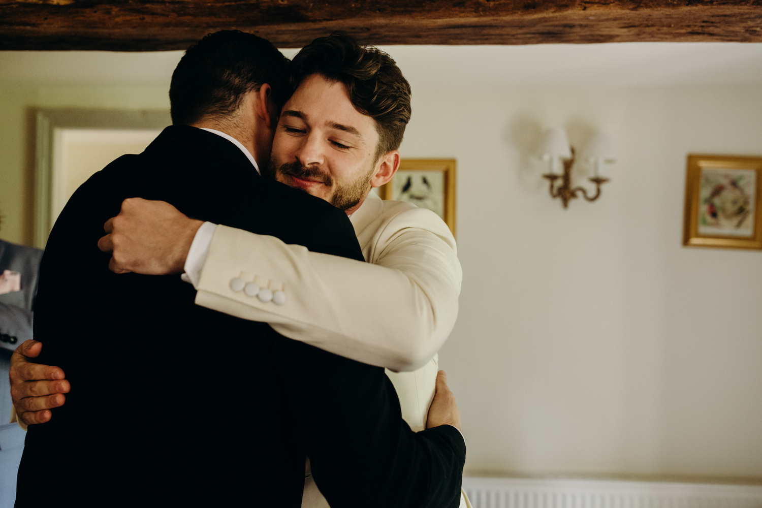 groom hugs best man