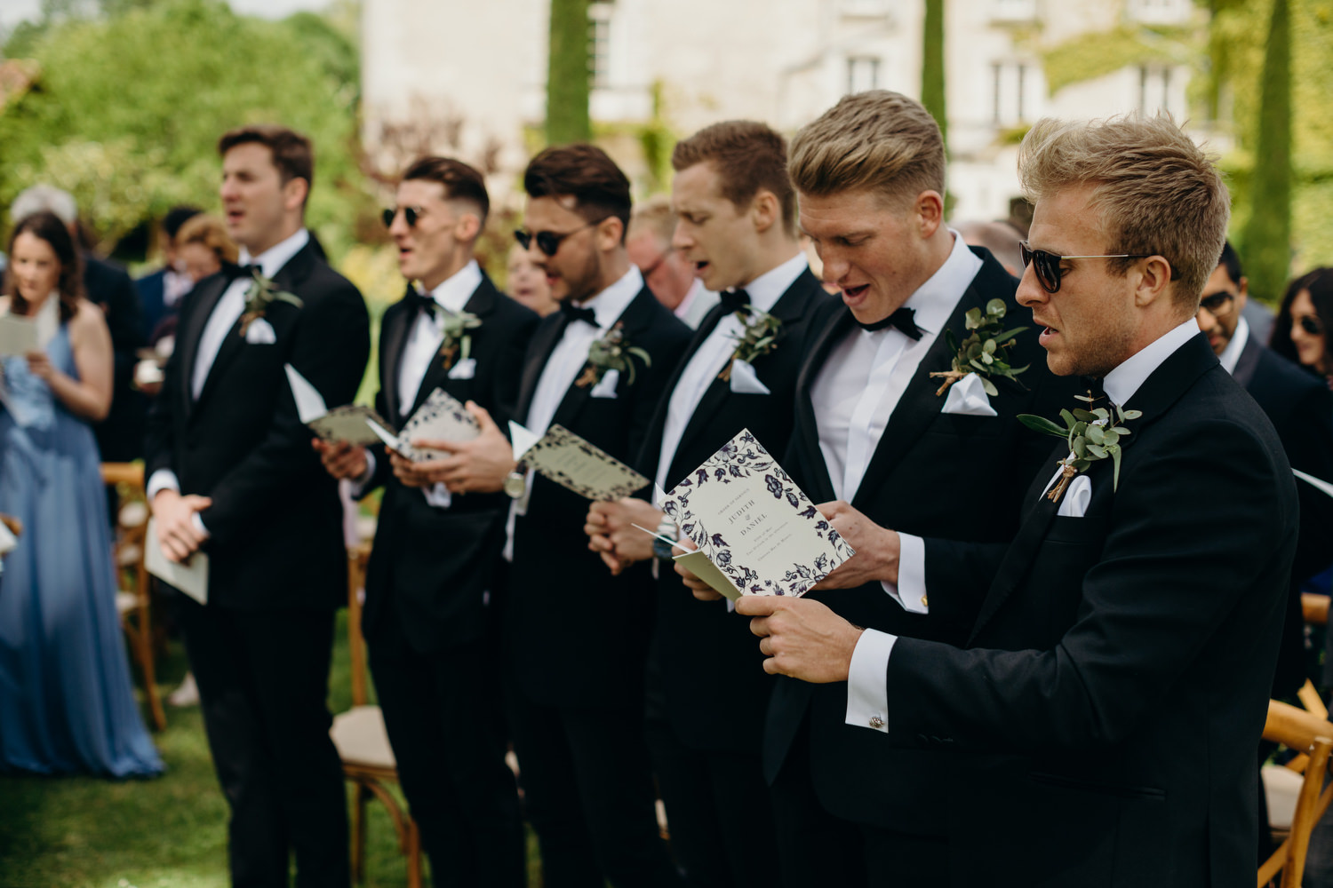 ushers sing at outdoor ceremony