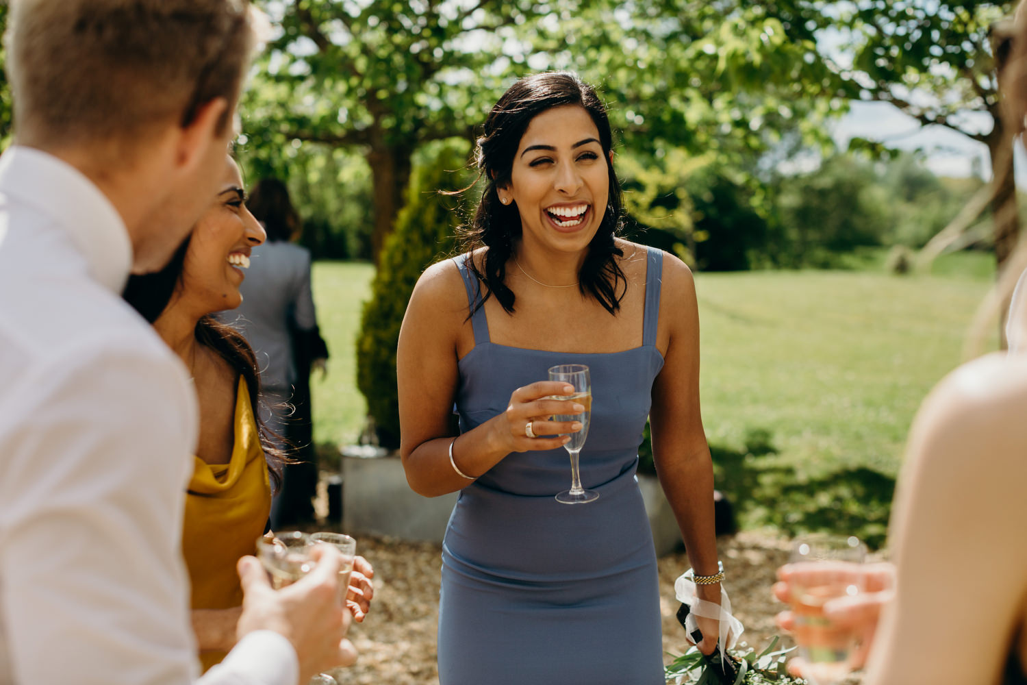 bridesmaid laughing at wedding in France