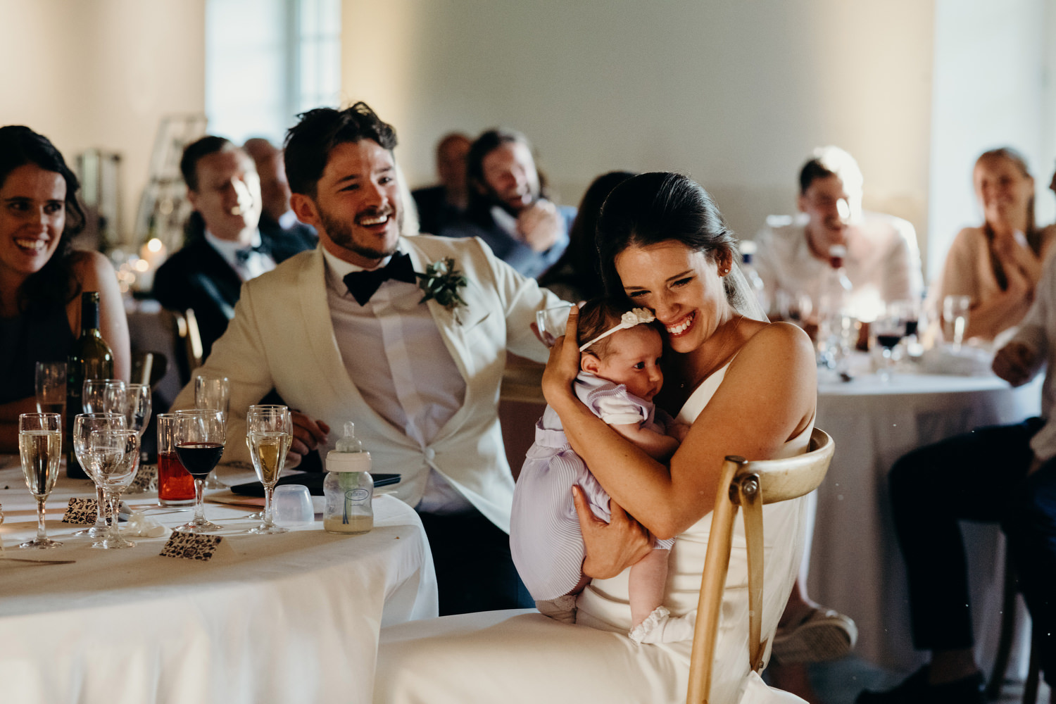 Bride hugs baby during speeches