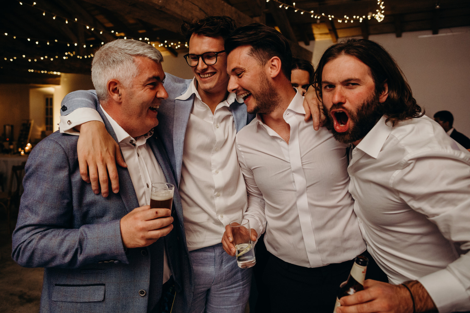 guests hug at wedding