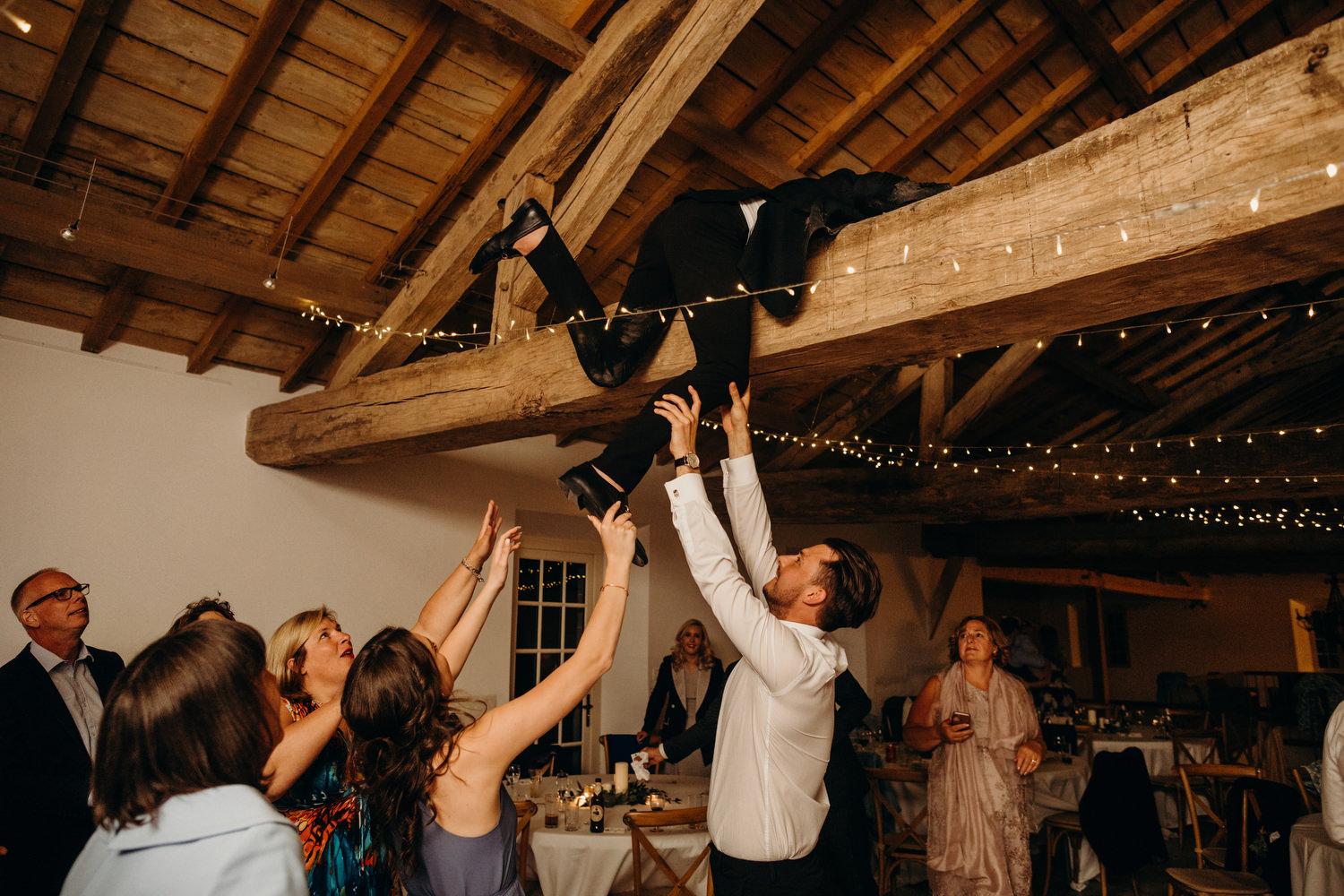guest climbing beam at wedding
