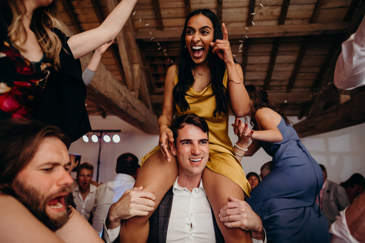 happy guest on shoulders at wedding