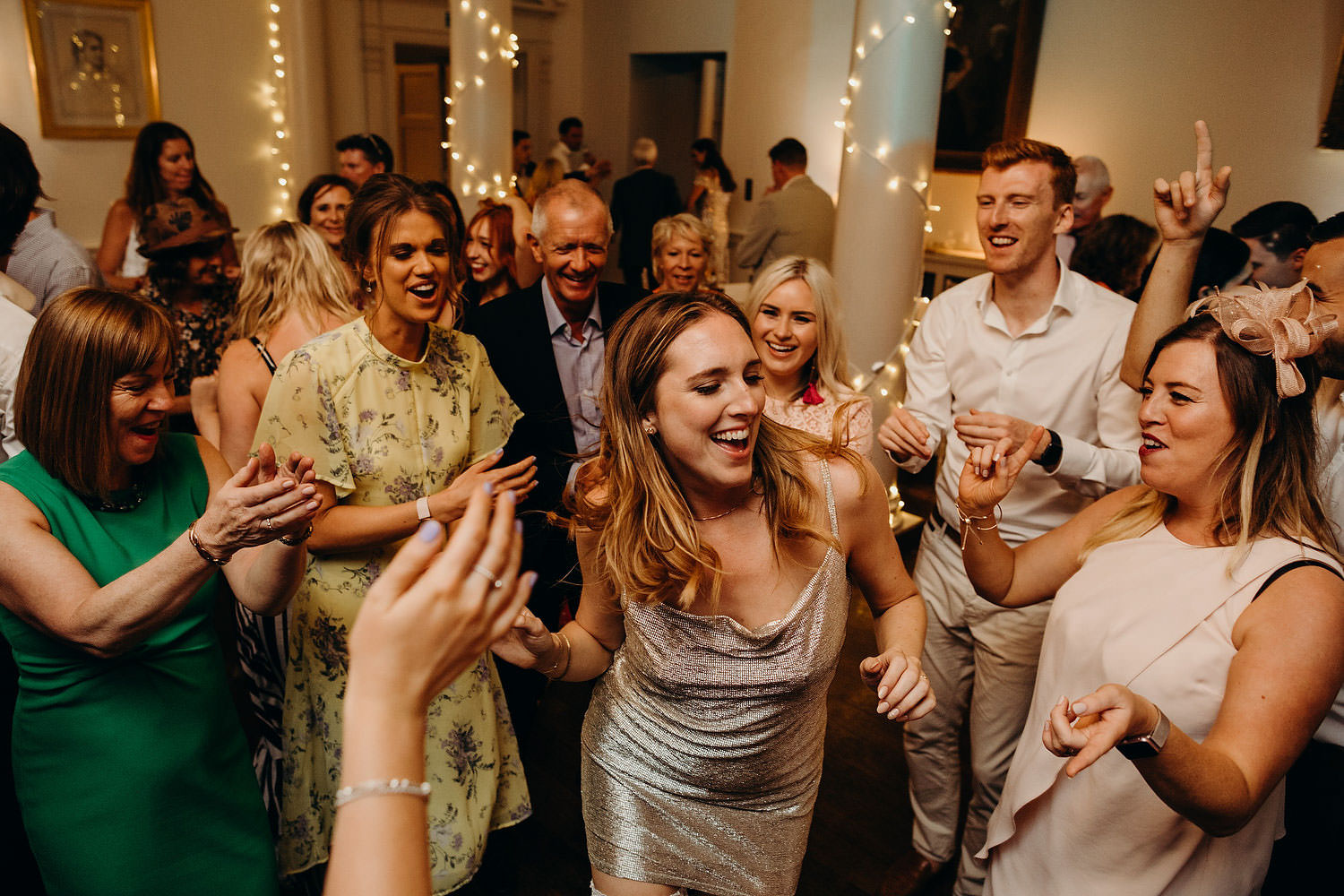 bride dances with guests cheering