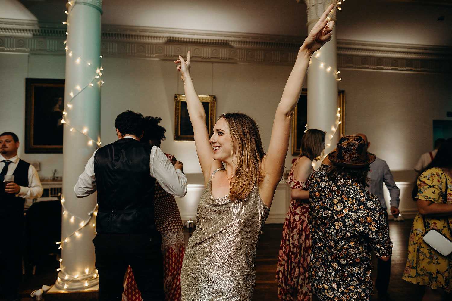 bride putting hands up in air