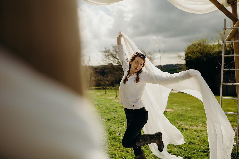 woman dancing on morning of wedding