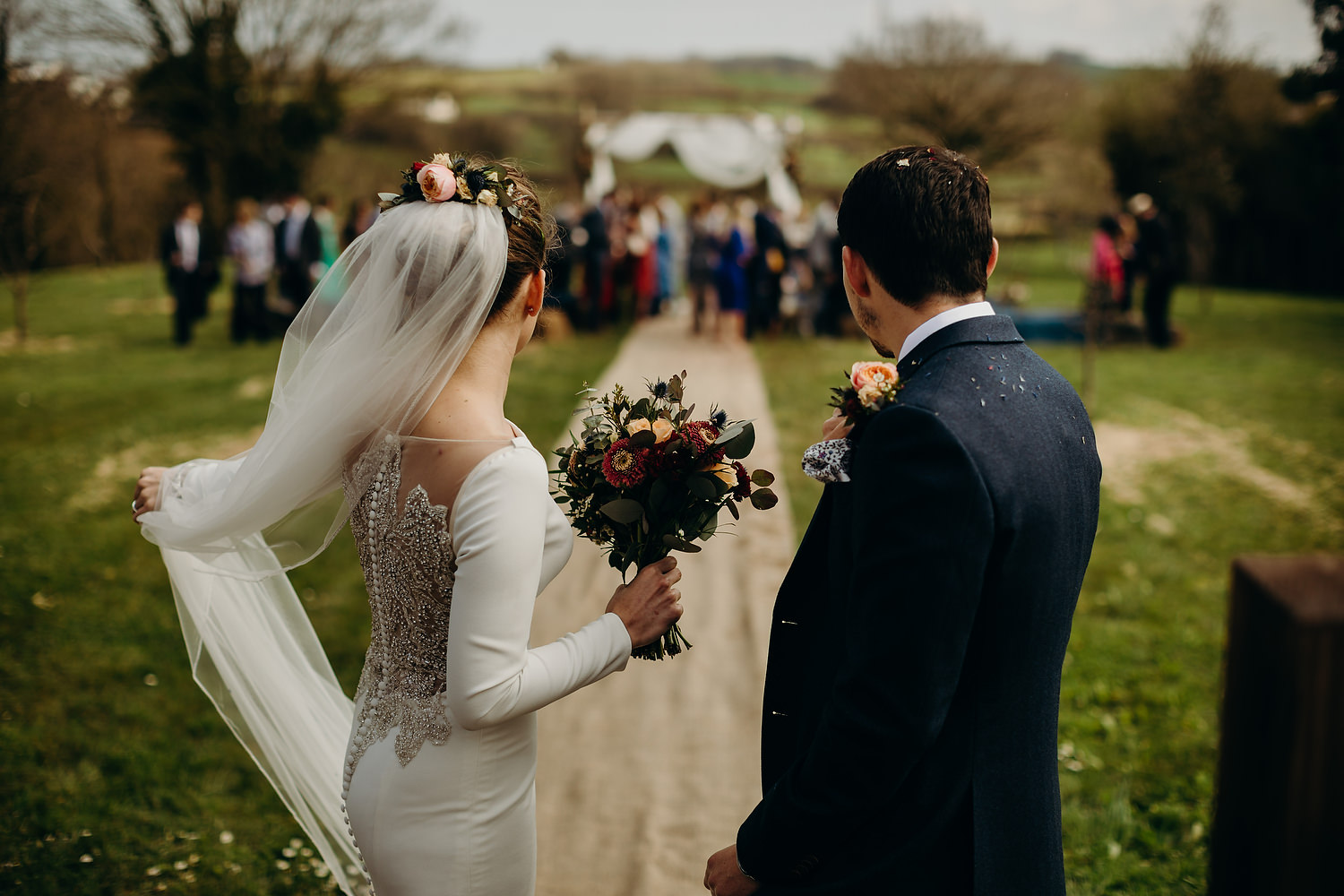 bride and groom covered with confetti