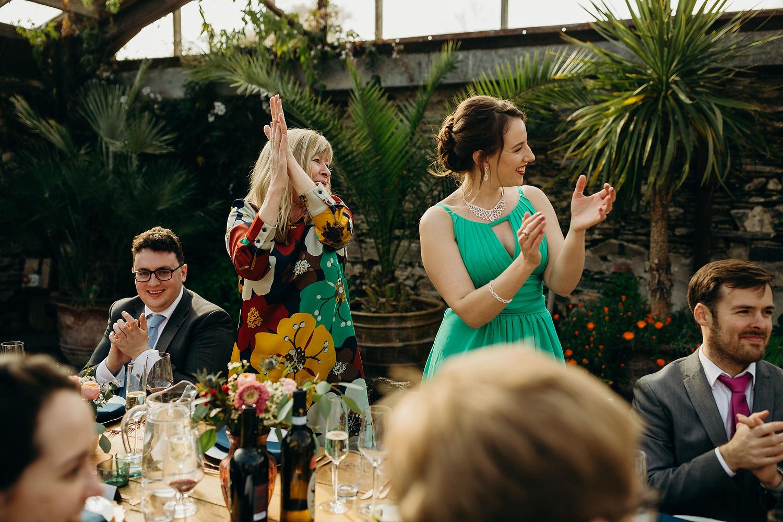 guests clap during entrance