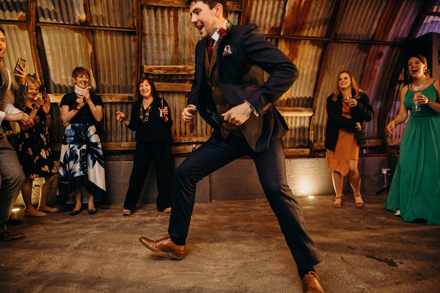 groom dancing at wedding