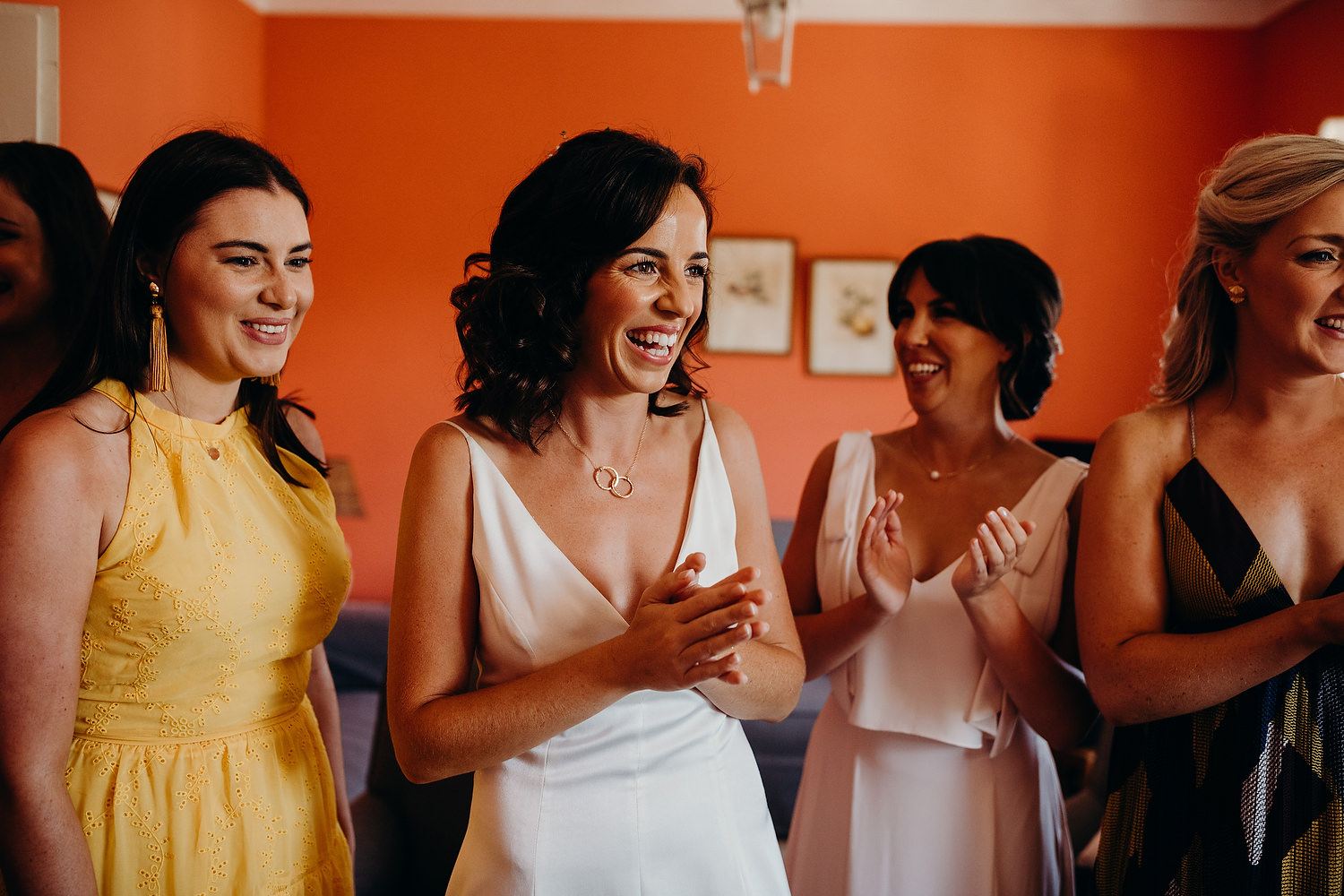 bride smiling with friends