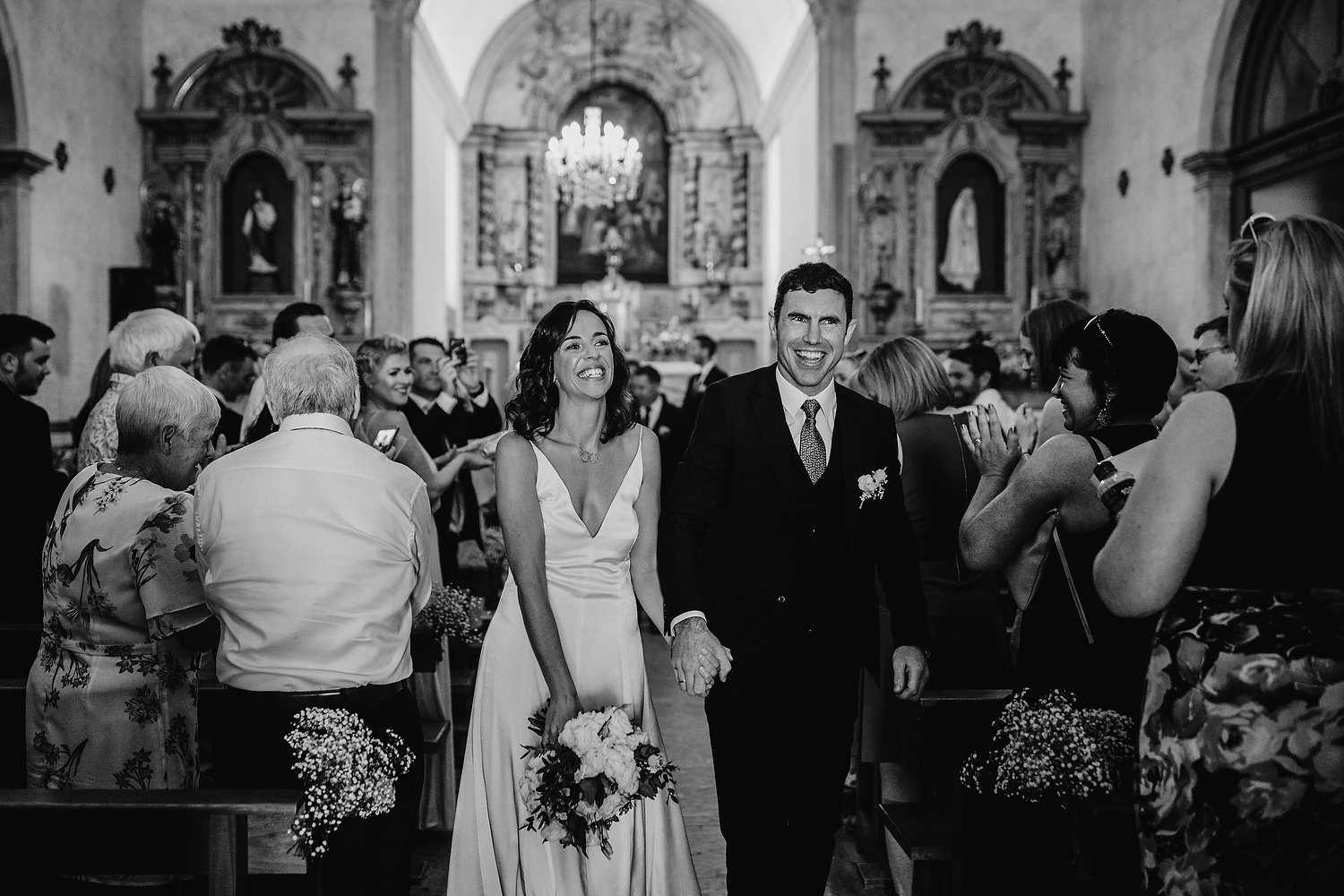 bride and groom walking down aisle