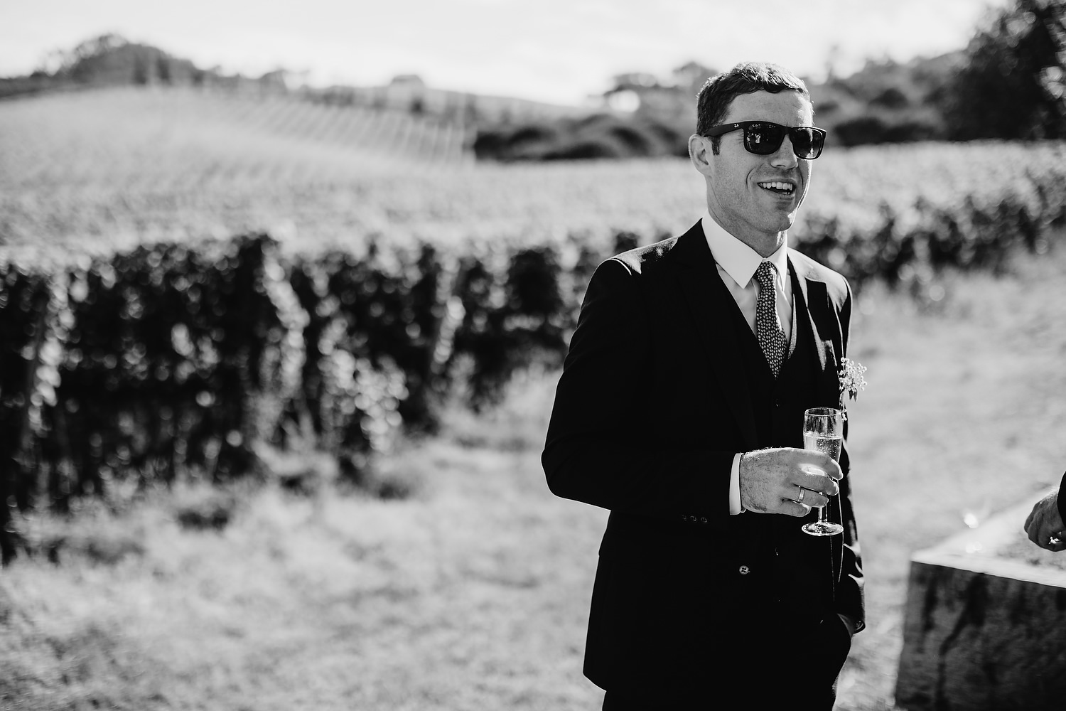 groom with vineyard behind
