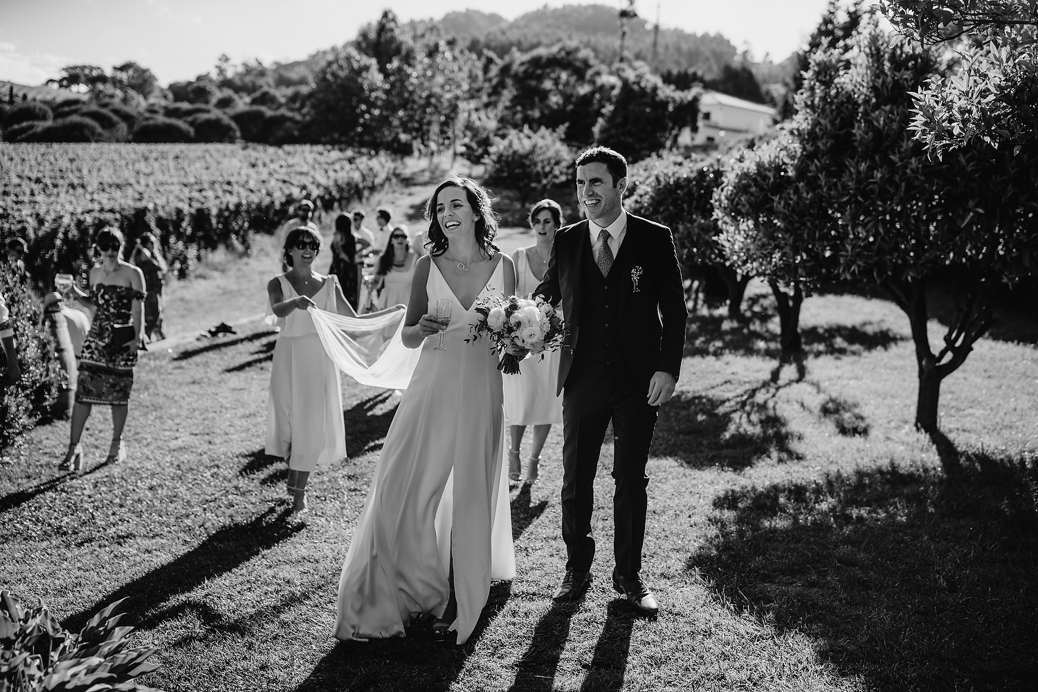 couple walking past vineyard