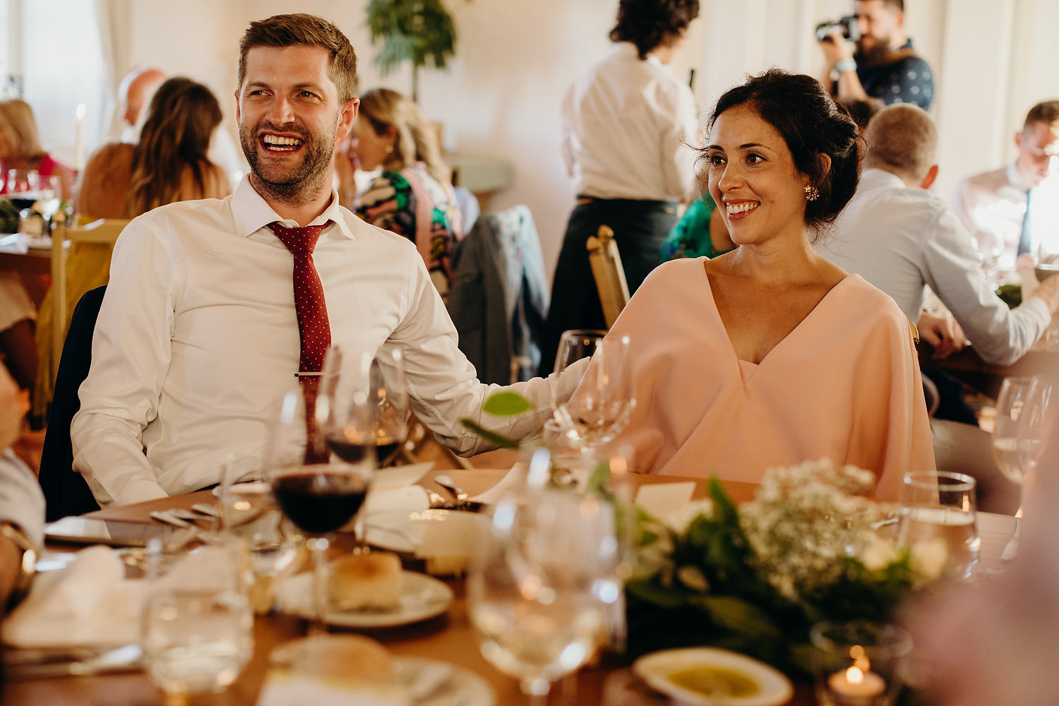 couple smiling talking during wedding breakfast