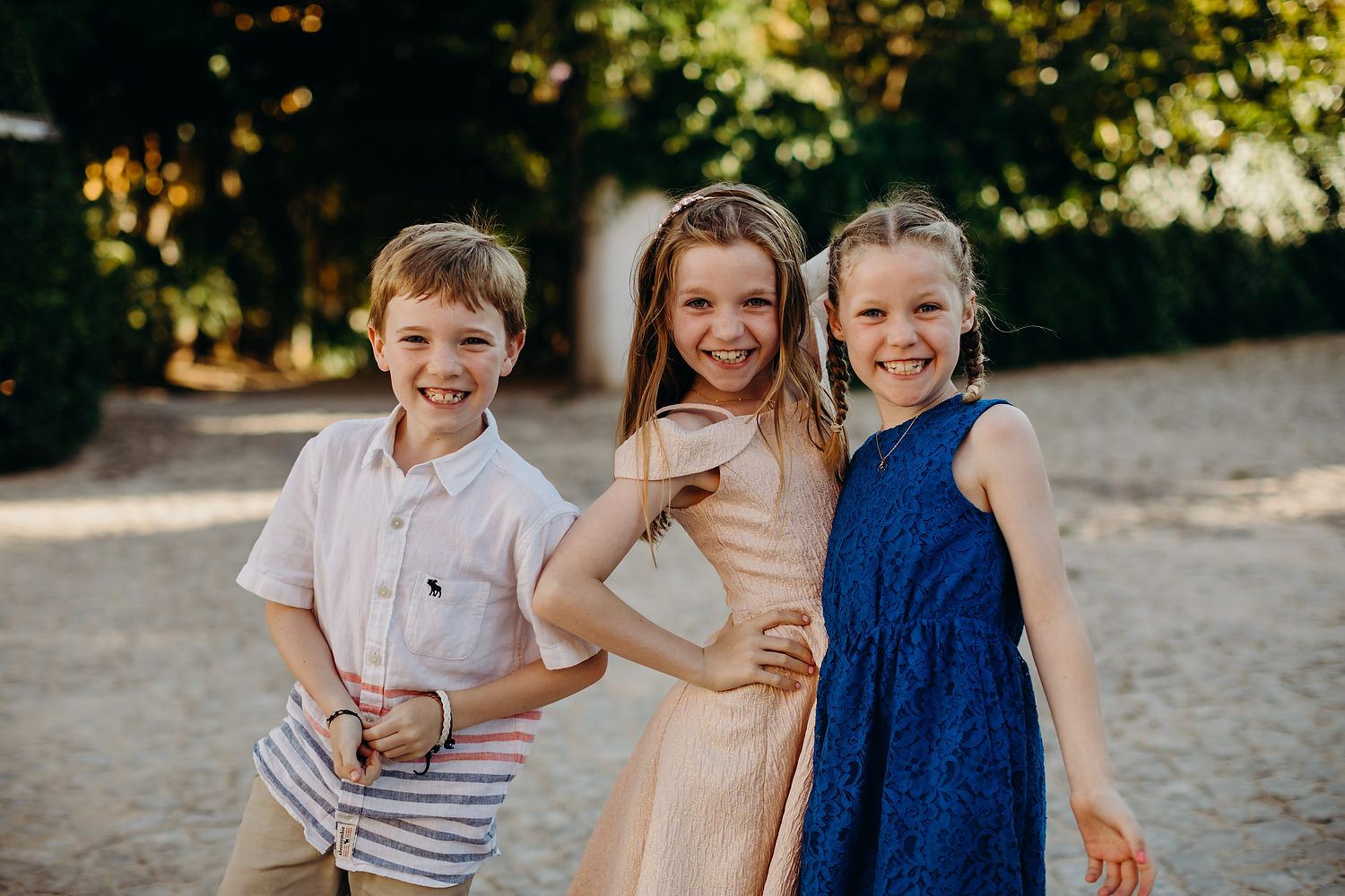 kids posing at Portugal destination wedding