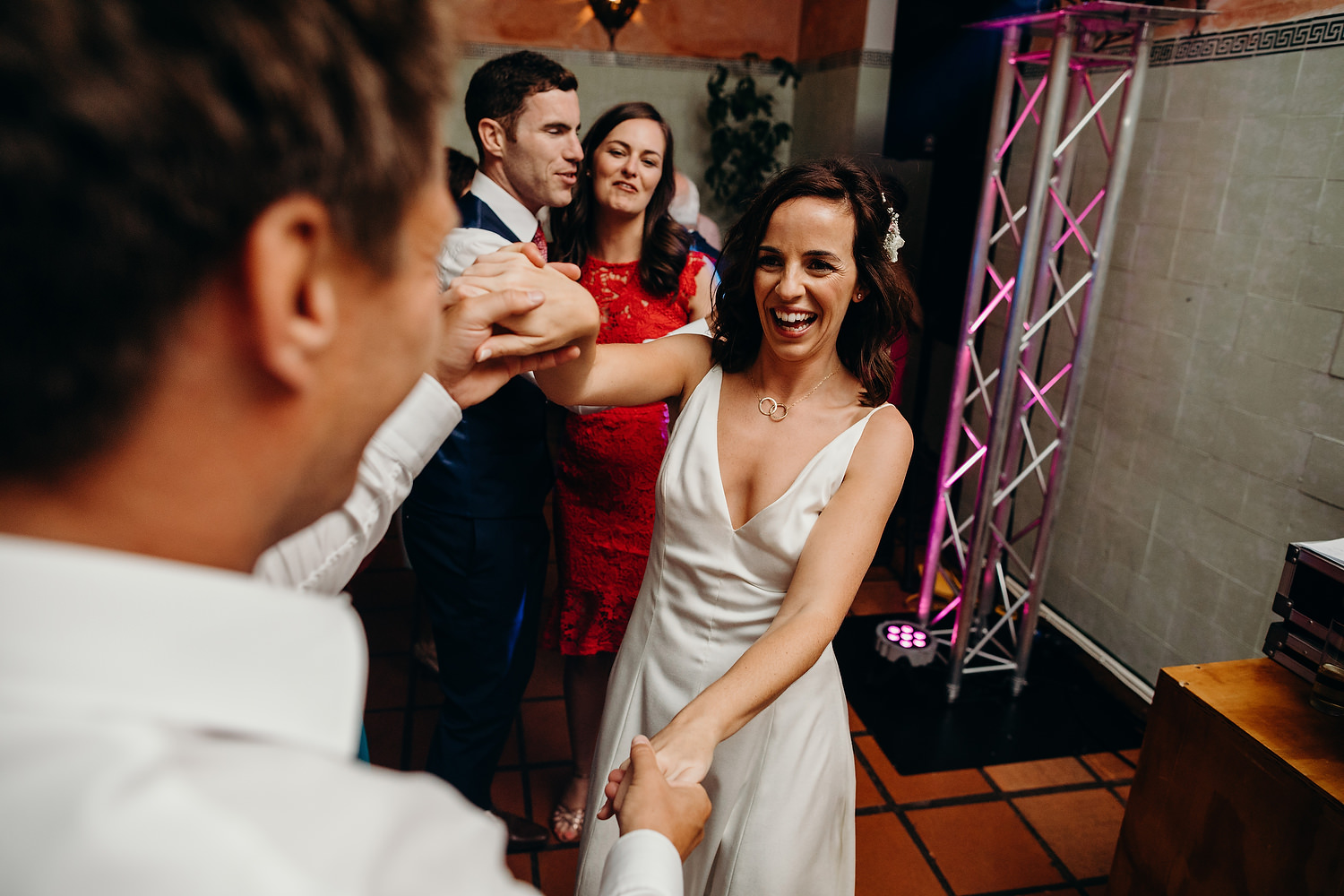 bride smiling on dancefloor