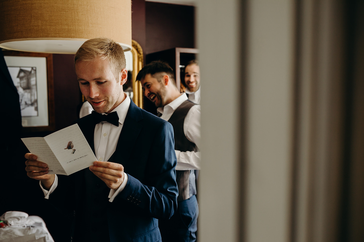 groom reading card from bride